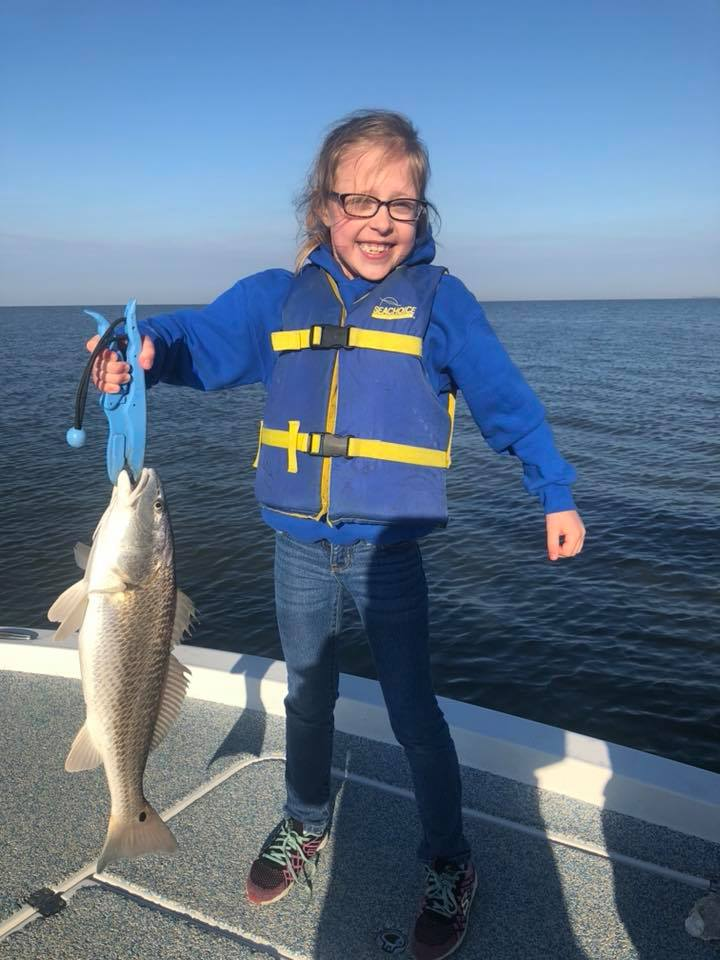 Junior Angler Catches Redfish.